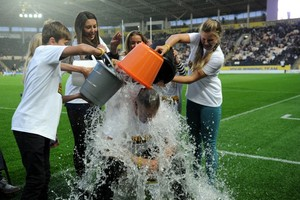 NEWS with story 29-8-14 Hull FC owner Adam Pearson takes part in the ice bucket challange before the Derby match with Hull KR at the KC Stadium. Picture: Simon Renilson