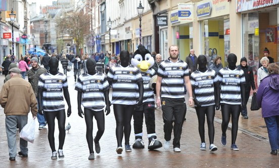 SPORT/NEWS...with James Smailes, 07/11/14  : Hull FC launch their 150th anniversary new home kit by placing 150 home shirts around the city of Hull. Pictured, Hull FC's Richard Whiting with Airlie Bird on Whitefriargate. Picture: Jerome Ellerby With VIDEO